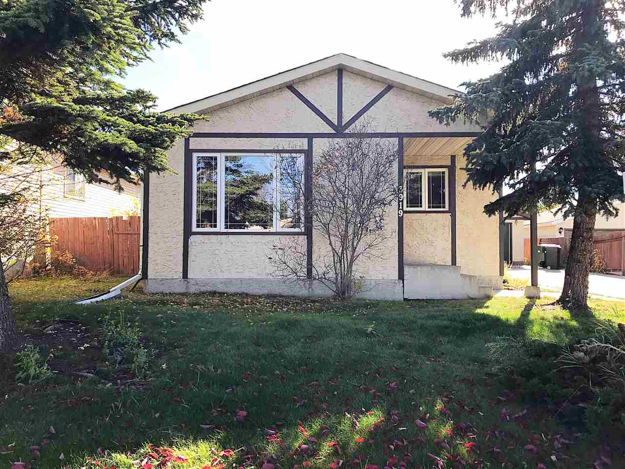 A great start! Located in popular Southpark-walking distance to the Leduc Recreation Center, Park N Ride, shopping, schools, parks and more. This unique 4 level split offers 3 bed/1 bath & 1,980 total sq.ft. Upon entry you are welcomed by a spacious living room with a large picture window. Hardwood floors carry from the living room through to the dining room. The adjacent eat-in kitchen has ceramic tile floors and oak cabinetry with upgraded hardware. Hardwood floors continue upstairs & through to 3 comfortable bedrooms. A 4pc bath completes this level. The 3rd level boasts a spacious family room with:vinyl windows, drop ceiling and pot lights, hardwood floors, wood burning stove, and is set up for a wet bar with 3 sets of upper oak cabinets and roughed in plumbing. The basement is partly finished with framing and drywall for two rooms that could be used for storage or an office. There is a large crawl space for added storage. A shared driveway leads to a 24 X 24 detached garage and fully fenced backyard.