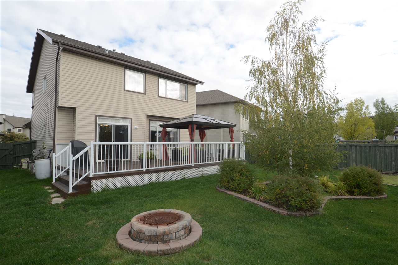 Ever dream of having a park-like oasis in your own back yard?  Look no further!! This 2033 sq ft, fully finished home features a large, SOUTH facing yard backing onto a walk way, a garden area, huge deck and tons of mature trees for fantastic privacy.  This 4 bed, 3.5 bath home is loaded with upgrades from the cherry hardwood floors, granite counter tops, marble, herringbone backsplash and fireplace surround,  gas fireplace and stove, formal dining room and upstairs bonus room! The fully finished lower level has a full bathroom, large bedroom and a huge rec room area.  New air conditioner, heated garage and a great shed for storage really makes this the total package.  Located walking distance to Johnny Bright Elementary, just two minutes to access the Henday and only 15 minutes to the airport this is a great family home.  A must see!