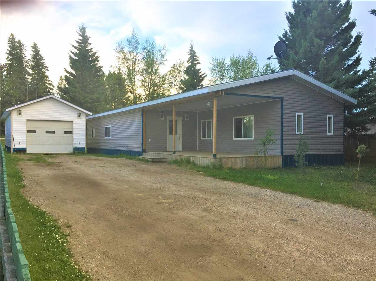 Three bedroom mobile home with large addition and many upgrades including drywall thoughout, laminate flooring, vinyl clad exterior, metal roof and 11' x 25' covered deck.  Property also has a 16' x 36' insulated garage/shop with 220 v. power and additional space to make it ideally suited for the handy man or for extra storage space.  Great opportunity for the first time home buyer or for a revenue property.