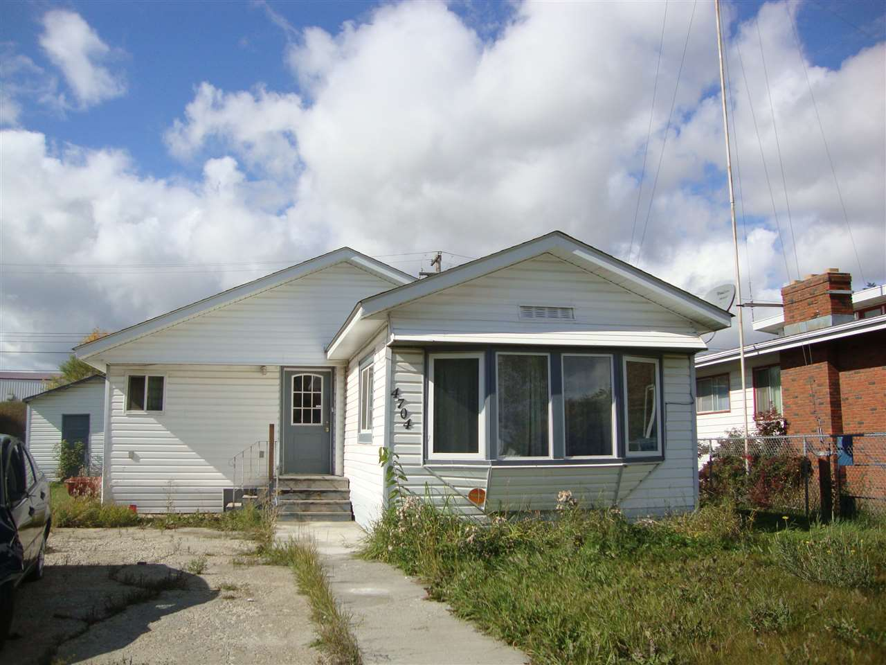 Home, storage shed, and huge shop on its own lot in Redwater.  Seller's father built this residence around a single mobile, added an addition, & re-sided all. Shop measures 15 x30 , has infloor heating, and an addition for storage.  Needs some work but good opportunity to own property for low dollars!