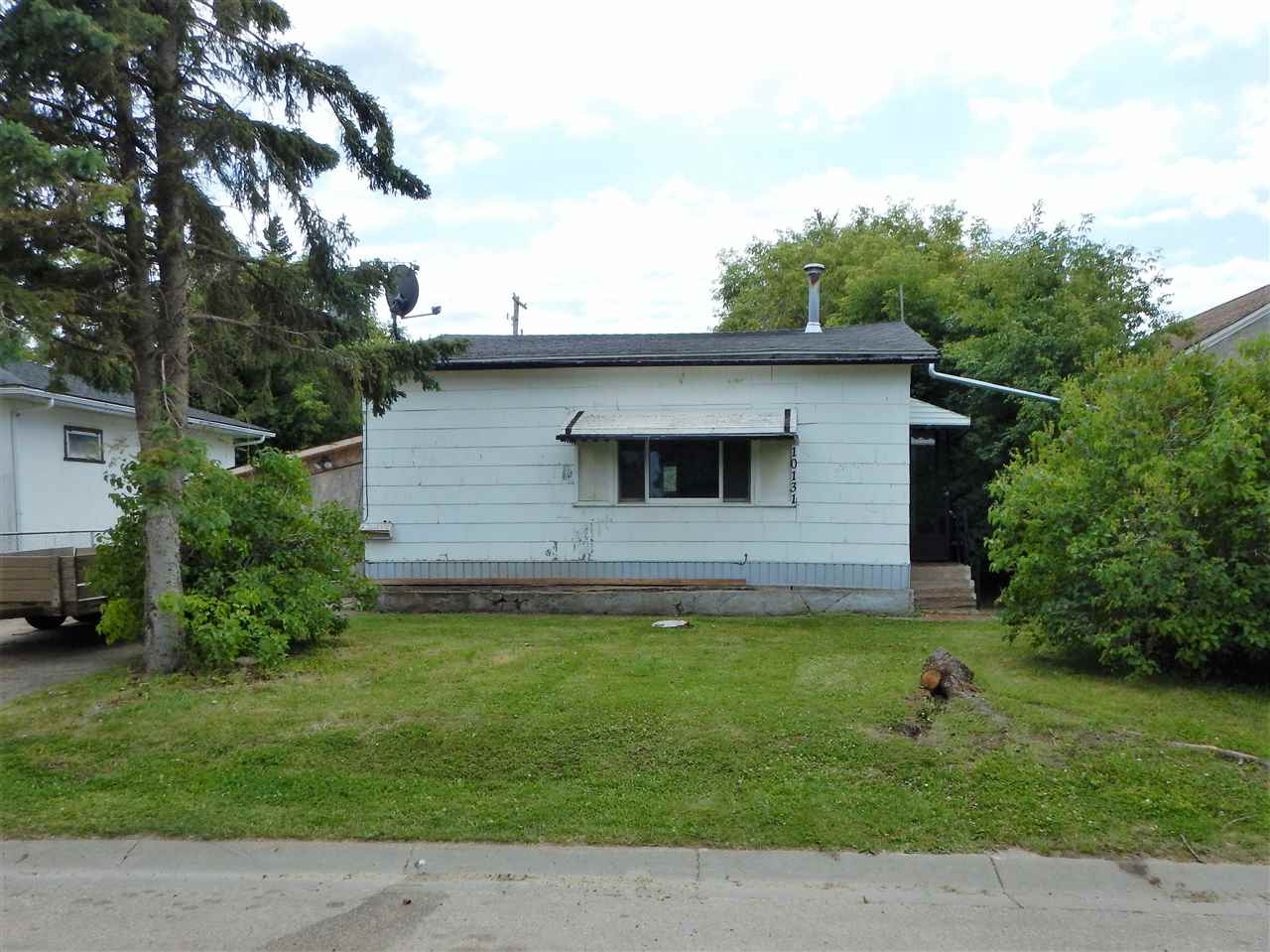 Great investment/rental property. This 2 bedroom home is centrally located near the high school and is walking distance to anywhere in Westlock. The lot is in a mature neighborhood and has extra privacy with a no exit back alley. Good sized lot. Plenty of room for a garage in the back. Lean-to on the side of the house that can be used for storage or it could be opened up and used as a carport. Nice value today and nice value in the future for development. Currently rented. Please give at least 24 hours notice for viewing.