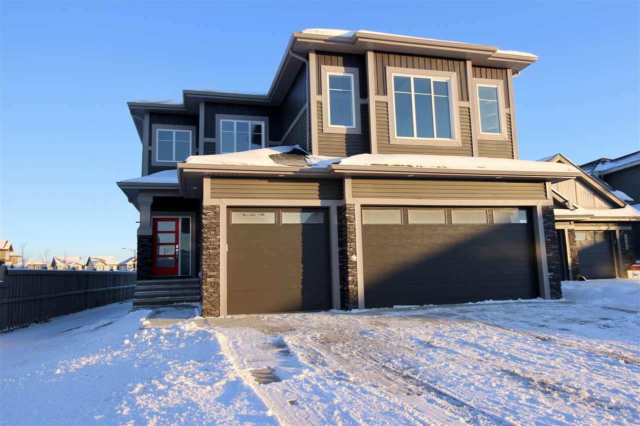 Located in the developing community of Rosenthal on a corner lot is this executive home featuring a triple car garage and almost 2500 sq ft of living space plus the 1000+ sq ft in the unsoiled basement that awaits your finishing touch. Enter into the grand foyer and be impressed with the wide open concept living space and soaring 2 storey ceilings in the living room with a mantle style fire place. The chefs dream kitchen includes a huge island, SS appliances, walk through pantry, granite counters and an abundance of cupboard space.The bright dining nook over looks the private yard with large windows and sliding patio door to the deck.Upstairs you will find the master oasis with recessed ceiling and extra lighting, a spa ensuite with separate tub and shower and his and her sinks. There are two other good size bedrooms, a large bonus room, upstairs laundry and a full main bath completing this level.