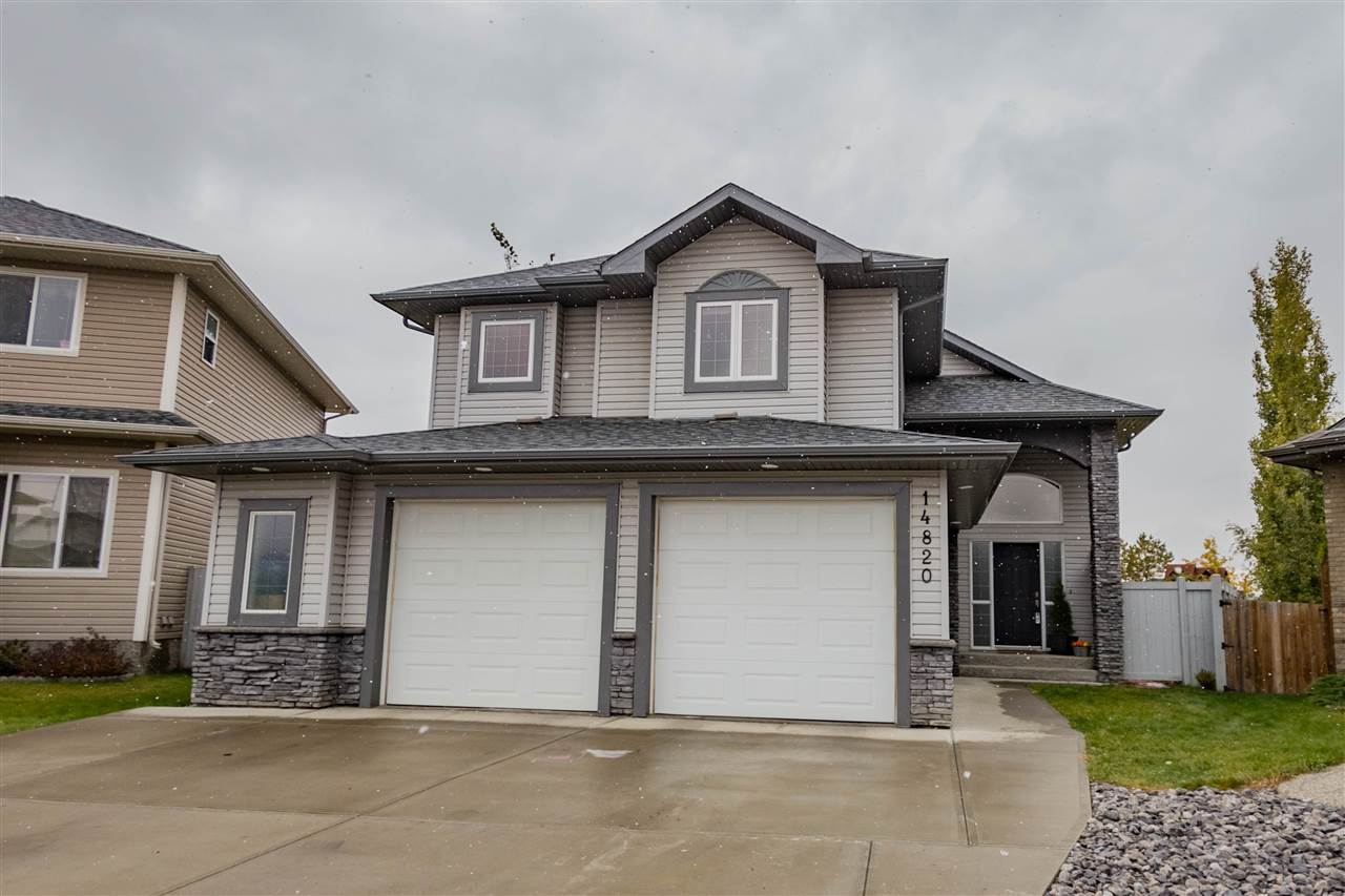 OUTSTANDING 1 1/2 storey BI-LEVEL in the Community of FRASER. This home greets you with a GRAND CERAMIC TILE FOYER with 13ft ceilings. The BRIGHT KITCHEN includes an oversized CENTER ISLAND and an abundance of crisp white cabinets. Open floorplan has large WEST FACING WINDOWS that create the PERFECT FLOW between your kitchen, dining & living space IDEAL FOR ENTERTAINING or family gatherings. Living area boasts a COZY GAS FIREPLACE with 12ft ceilings, 2 bedrooms & full bath complete the main floor. The MASTER-SUITE is on its OWN LEVEL, fit for a KING-SIZE BED, with a HUGE WIC, and ENSUITE. Basement is FULLY FINISHED with REC RM, 4th bed, full bath, LAUNDRY RM, & STORAGE SPACE. Attached double HEATED GARAGE (26x27) w/ built-in shelving & SEPARATE ENTRANCE into the basement. BACKYARD is perfect for kids & pets to run and play, is beautifully landscaped with PRIVACY TREES, firepit, LOW-MAINTENANCE DECK with STORAGE BELOW. Easy access to the Henday, Manning, shops, restaurants, PARKS, TRAILS, & the RAVINE.