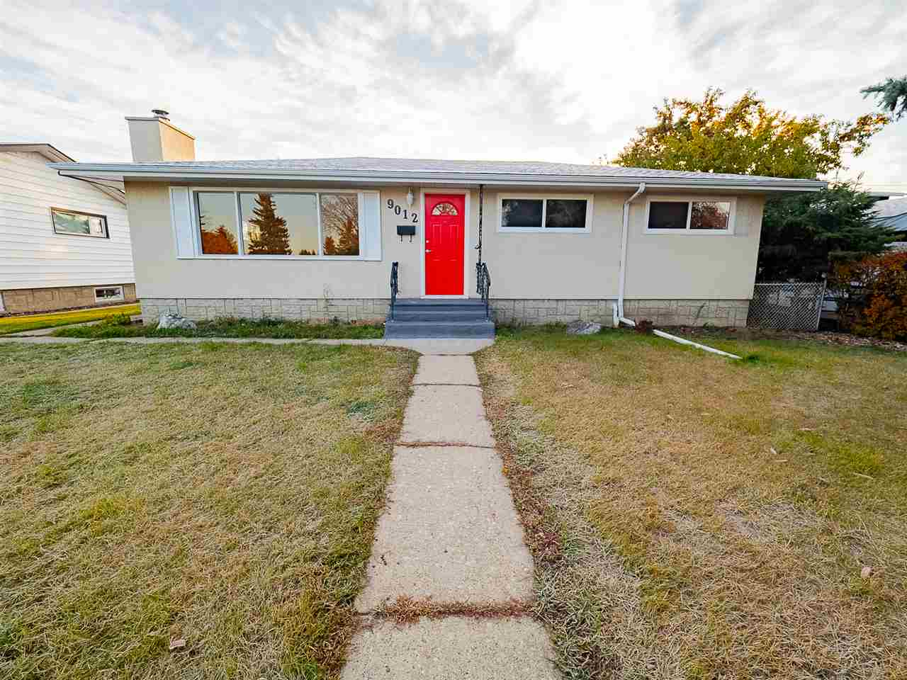 Totally renovated bungalow directly across from park setting! Comes with a separate entrance to basement with 2 bedrooms, new kitchen and bath, washer and dryer, (seller is waiting for occupancy certificate) 5-bedroom, 2 new baths bathroom, over 2000 sqft of developed living space, large fenced yard with over sized double garage 24 x 22 !  New roof, windows, doors, flooring, kitchen, new laminate up and carpet down. Fabulous revenue earner! Live up, rent down! Top floor has potential rent for $1150 plus $300 utilities, basement approximately rent for $900 plus $300 utilities, the garage rent for $200 per month. Positive cash flow or excellent mortgage helper. Shows a 10 out of 10!