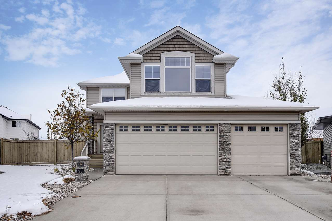 This two storey 2500 SF (builder size) home, in a cul-de-sac on a LARGE Pie Lot, with a FF Basement and TRIPLE Garage w rear door, is move in ready. The bright and open floor plan impresses as soon as you walk in the door. The open concept main floor boasts a large kitchen w maple cabinetry, SS appliances, a breakfast bar, and walk in pantry. This space is open to the dining space surrounded by large windows over looking the raised deck & fully landscaped outdoor space. The family room is bright and inviting, with a gas fireplace. What a great entertaining space for family and friends. A garage access mudroom w MF laundry and powder room complete this floor. Above you find a Large bonus room for additional family time. The Master suite is compete with soaker tub, stand up shower and his/hers closet. Two generous bedrooms and a full bath complete this floor. Below is a FF basement with rec space, dry bar, a 3 pc bath and another bedroom. This home also includes AC, Central VAC and the kid play structure.