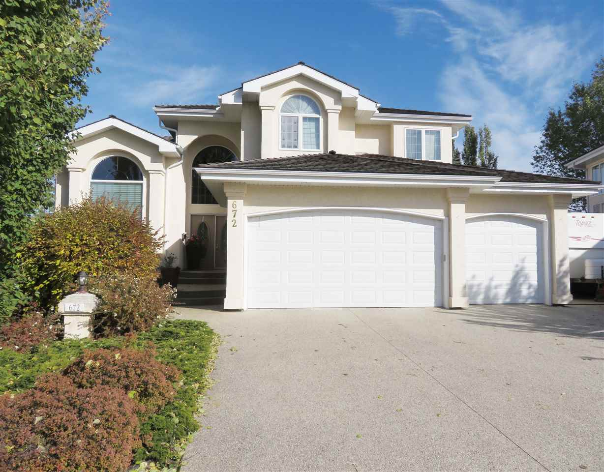 WOW! A gem nestled in a quiet keyhole, 'steps' to ravine trail & parks in prestigious Eagle Ridge. Immaculate, renovated 4 bedrm Ace Lange home. Executive Family 2 sty boasts over 5000 sf (ttl) of luxury finishes incl a F/Fin bsmt. Dramatic sweeping curved stairwell greets your guests as they enter this open concept plan home, perfect for those who love to entertain. Huge den w/dbl French drs adjacent to the spectacular vaulted Great rm boasting a wall of windows & lots of B/I shelving. Chef's kitchen w/newer upgraded S/S appliances, a massive island w/breakfast bar, granite, W/I pantry & loads of sleek white cabinetry. The sunny nook area accesses the massive deck (2017), perfect for outdoor entertaining & overlooking the massive beautifully landscaped yard. Hardwood galore & contemporary tones are found throughout. Upstairs are 4 very spacious bedrms. The master suite will accommodate most any furnishings w/a separate sitting area, large W/I closet & a sumptuous ensuite. Bsmt has a FP & wetbar. A 10!