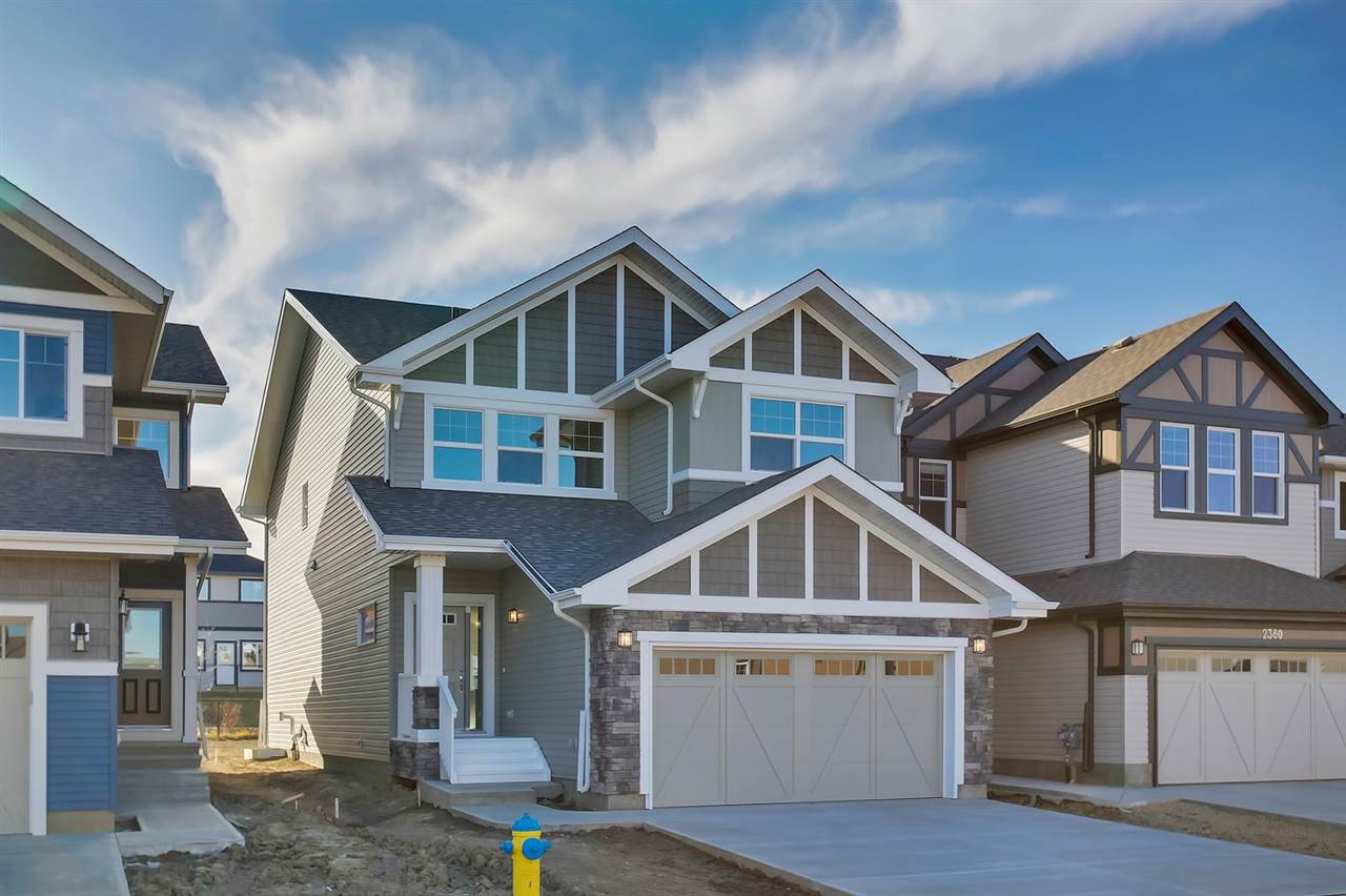 The perfect location in Chappelle, backing onto a walkway leading to the school - small town feeling in the big city of YEG! The Escalade II A built (2018) by Daytona Homes is a 2384sqft wonderful family home ? 4 beds, 2.5 baths & double attached garage! A spacious foyer welcomes guests & you will love the open concept style ? laminate & tile flooring throughout & 9 foot ceilings on the main floor. The Kitchen is beautifully finished with quartz countertops, beautiful cabinets, a prep island, an extended eating bar, ceramic backsplash, walk through pantry & a spacious breakfast nook! The bright & large living room features a fireplace & the powder room completes the main floor. Retreat upstairs to the bonus room ? perfect for family relaxing nights.  The spacious master suite features a 5 piece ensuite (2 sinks & extra large shower & soaker tub) & a walk in closet. Bedrooms #2, #3 & #4 are all a good size, the upper laundry room & 5 piece (2 sinks) bath complete this level.