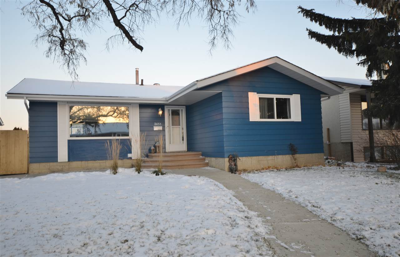 Location, location, location! Renovated bungalow located in south-central Edmonton close to shopping, LRT and Duggan Elementary & Harry Ainlay High School. The main floor of this cordial home features 3 bedrooms above grade with en-suite in master, remodeled full bath, spacious kitchen with ample counter space and white barn doors opening to formal dining area, large living room and a grand foyer with plenty of closet space for your whole families winter attire. Basement is 90% finished with a wonderful family/recreation room, large laundry area with extra storage, a 4th bedroom featuring an oversized walk-in closet, office/den and a modern 3rd bathroom with a rain shower head and jet sprays. This home is located on a beautiful large mature lot with a double garage and back alley access...WOW!