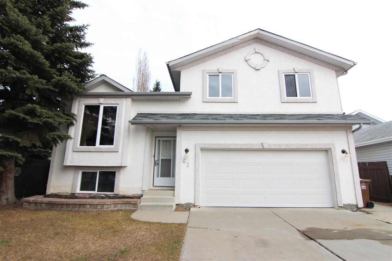 The location of this 3+2 bedroom 5-level split home is hard to beat, situated NEXT TO A PARK and BACKING ONTO TREES, with easy access to St. Albert Trail and the Henday! This home has many updates, including: exterior stucco, kitchen, bathrooms, flooring, furnace with central air conditioning, hot water tank, shingles, and much more! The main floor boasts a formal living and dining room, as well as a spacious EAT-IN KITCHEN with patio doors leading out to the deck! Stepping upstairs you will find 3 generous bedrooms, including the master bedroom with 2 FULL CLOSETS and a 3-PIECE ENSUITE! The lower level offers a cozy family room with wood-burning fireplace, and just a few steps down you'll find a full 4-piece bath, 2 more bedrooms, the laundry room, and a fourth room with rough-in for an indoor hot tub! The large backyard is fenced and has many trees, and also offers a covered deck, a gazebo, and a storage shed! The double attached garage measures 20x20 feet.