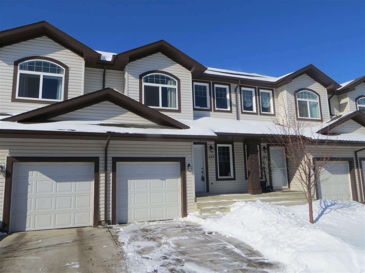 Assume the mortgage with 2.44% interest rate, $15,500 down payment, save on CMHC & legal fees! Townhome w/ attached garage! This 3 bedroom townhome comes with an affordable condo fee and unlike other complexes it has a full basement!  Terrific floorplan and Attached Garage (10x19) plus extra parking in front of the garage.   Stainless steel appliances, granite countertops, laminate floors and a landscaped yard with deck.  The open layout of the main floor is stunning and the modern kitchen features a large island with a built-in sink, an abundance of cupboards and counter space and a spacious dining area. The additional walk-in pantry adjacent to the kitchen is perfect for keeping your life organized. The kitchen moves seamlessly into the central living room, complete with a cozy corner fireplace and easy access to your west facing back deck with privacy screen. The bedrooms upstairs are generous in size and offer ample closet space.  The master bedroom features a walk in closet and full bathroom ensuite.