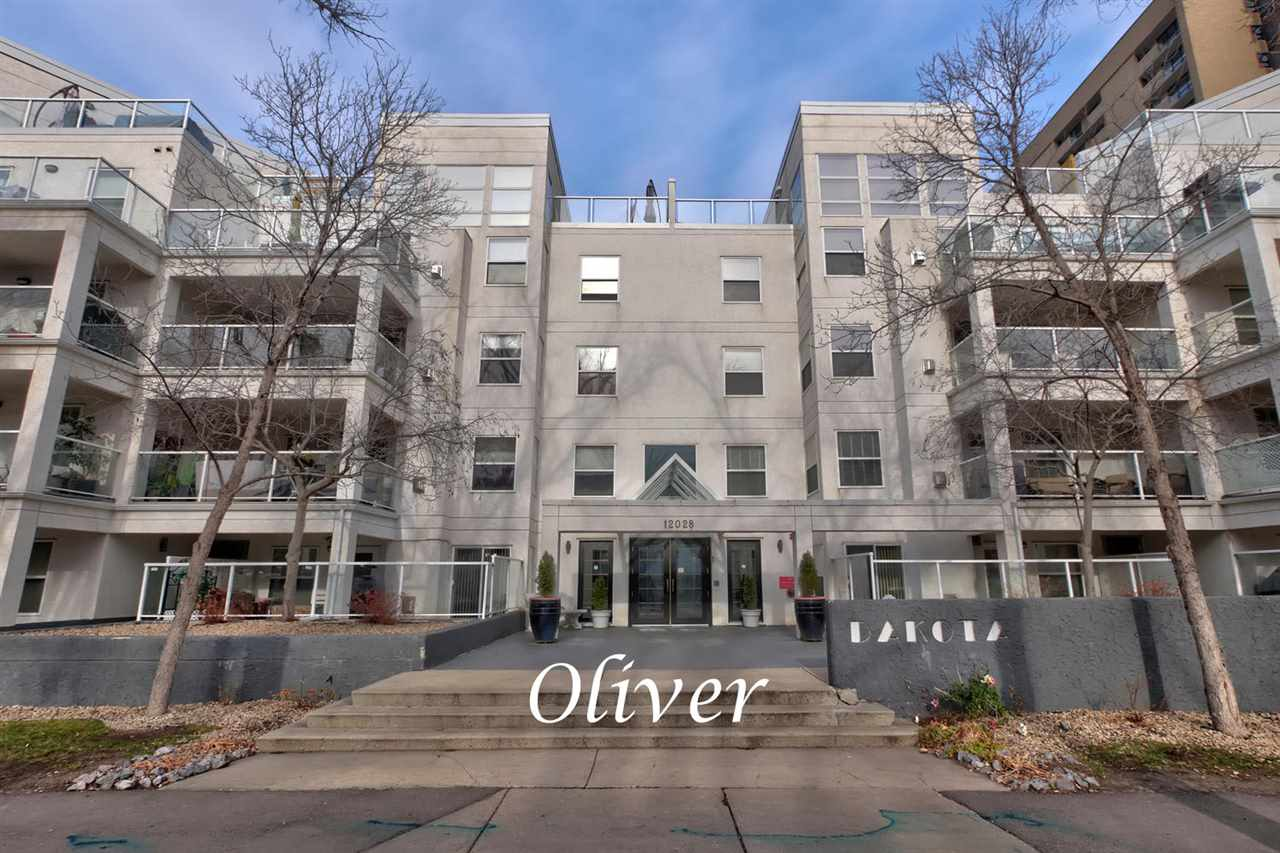 Welcome to the Dakota and this pet friendly (with board approval) and extremely well managed building. Located in the heart of Oliver this trendy condo is a mere one block from the Brewery District and a short walk to The Oliver Shopping Center, 124th street, Grant MacEwan and Rogers Place. This 1060 sq ft corner unit has a super unique open floor plan and multiple large windows allowing for tons of natural light. Features of this 2 bedroom, 2 bathroom condo include a large island kitchen with an eat-up bar, lots of cupboard space and newer Samsung appliances, the living room with a gas fireplace, the dining room with access to the deck that has a bar-b-que outlet, a flex space adjacent to the kitchen ideal for an office, the master bedroom with a large W-I closet and 3-piece ensuite, a 2nd bedroom, a 4-piece main bath and the in-suite laundry. Included is one underground heated parking stall and bicycle storage. Directly across the street from Paul Kane Park, this attractive condo is a must to view!!