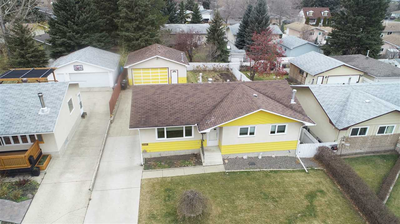 BRIGHT AND SUNNY BRENTWOOD BUNGALOW CENTRALLY LOCATED AND DIRECTLY ACROSS THE STREET FROM PEACOCK PARK. ALSO VERY CLOSE TO 3 ELEMENTARY SCHOOLS, THE SHERWOOD PARK MALL, AND THE GLEN ALLAN RECREATION COMPLEX. THE MAIN FLOOR EXTERIOR DOORS AND WINDOWS (TRIPLE PANE) HAVE ALL BEEN REPLACED. THE SHINGLES AND DRIVEWAY ARE ARE IN GOOD CONDITION AND THE HOT WATER TANK AND FURNACE (HIGH EFFICIENT)HAVE BEEN RECENTLY REPLACED. THERE IS A GAS LINE HOOKUP BEHIND THE HOME WAITING FOR YOUR BBQ OR FUTURE FIREPIT. THE OVERSIZED HEATED GARAGE (24' X 26') HAS LARGE WINDOWS AND A CENTER FLOOR DRAIN. THE BASEMENT IS FULLY DEVELOPED WITH A GAMES ROOM, BEDROOM, AND A FAMILY ROOM C/W A BRICK, GAS FIREPLACE. THERE IS A DOORWAY AT THE TOP OF THE STAIRS AT THE BACK DOOR MAKING IT EASY TO HAVE A SUITE IN THE BASEMENT.
