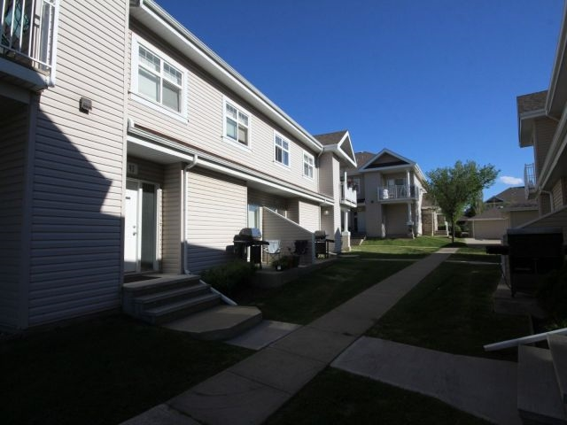 This well maintained walk-up condo comes complete with Single Detached Garage as well as an Additional Energized Parking Stall. End unit with street view; garage is also an end unit (closest to the building). Floor plan is open concept with large kitchen. Master bedroom has a walk-in closet. Ample storage throughout as well as a 900sf crawlspace. Air Displacer keeps the unit nice and cool during the summer months. Walking distance from Father Michael Mireau Elementary/Junior High K-9. 10-minute walk to the lake for swimming/kayaking etc and ice skating/ice fishing in the winter.