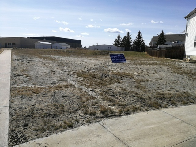 This corner lot backs onto the School grounds and will accommodate a great variety of home styles and as the only lot with back alley access, you can build a garage or shop or park your RV off street.  Location, Location, Location!  Large diamond shaped lot adjacent to the walking trail.  Tofield is just 30 minutes east of Edmonton and Sherwood Park and 45 minutes from the Edmonton International Airport (YEG).  Tofield offers a health centre, medical clinic, pharmacies, 2 schools and numerous recreational opportunities.  Welcome home!