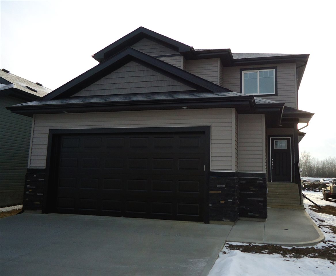 Brand new single family home in Ardrossan!  The open concept main floor features hardwood throughout, a bright kitchen with island, quartz countertops and large pantry, spacious dining area with garden door to the back yard, living room with gas fireplace, laundry and half bath.  Upstairs is a centralized bonus room, good sized master with walk-thru ensuite to the walk-in closet, two more good sized bedrooms and another full bathroom.  The basement and main floor both boast 9' ceilings.  The double attached garage is oversized (23x24') and has an 8' door so you can fit your truck with ease.