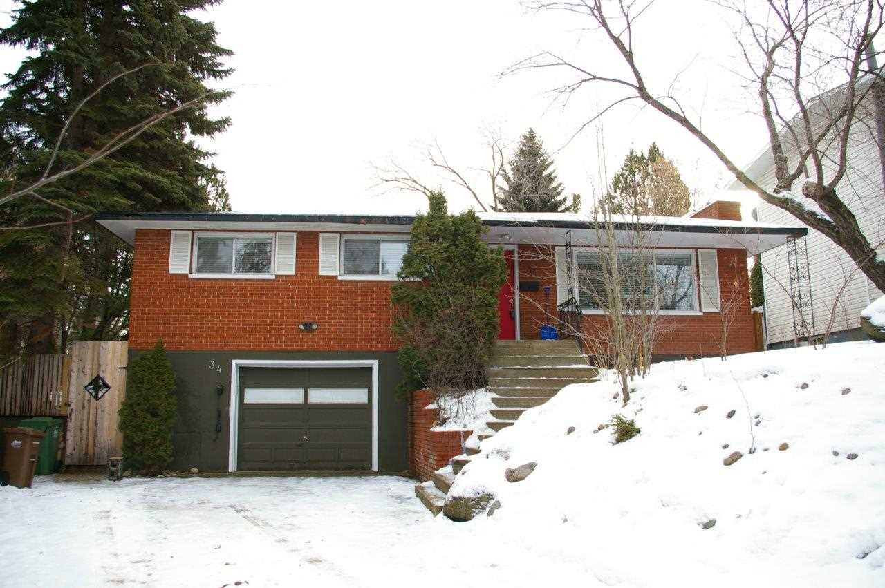 One of a kind fully renovated open concept home with incredible backyard in the desired heart of Canada's #1 city. If you are looking for a mature setting with all the modern upgrades, the search is over. Located within a 5 min walk to the Grovenor outdoor pool, downtown farmers market and to several schools & parks. This beautiful 4 bdrm 3 bath home is located on a quiet crescent & backs onto the stunning Grenadier Park. You will be amazed at the private backyard oasis that has been professionally maintained complete with new wood fences, fire pit, large concrete patio, fruit trees. Inside is a striking kitchen with plenty of natural light & everything you would expect:granite counter tops, slate tile floor, S/S appliances (5 years young).Throughout the main floor is beautiful real hardwood flooring leading to 3 spacious bedrooms including master with ensuite and walk in. Completely developed lower level has 3 piece bath and 4th bedroom/office, cozy family room and storage. Show and sell with confidence.