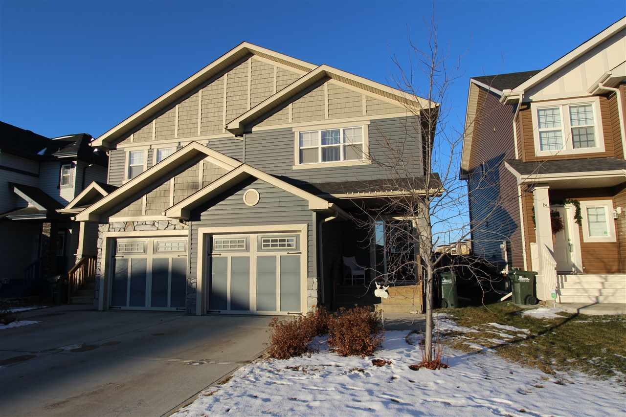 To live, shop and play, you can't beat Ellesmere Way! This modern half-duplex features 1,137 sq. ft., 3 bedrooms up, and an ATTACHED single garage!  9 ft ceilings, central air conditioning, rough-in for future master bedroom ensuite, durable laminate flooring, maple cabinets, and an open-concept layout are highlights of this 2 story home. The yard is fenced and landscaped and comes complete with a deck, while the garage is drywalled and insulated. The basement has rough in and framing for a bathroom and is framed for a family room and bedroom/storage. The location offers great access to the Henday and all of Sherwood Park's amenities, and this unit is super affordable with NO CONDO FEES!
