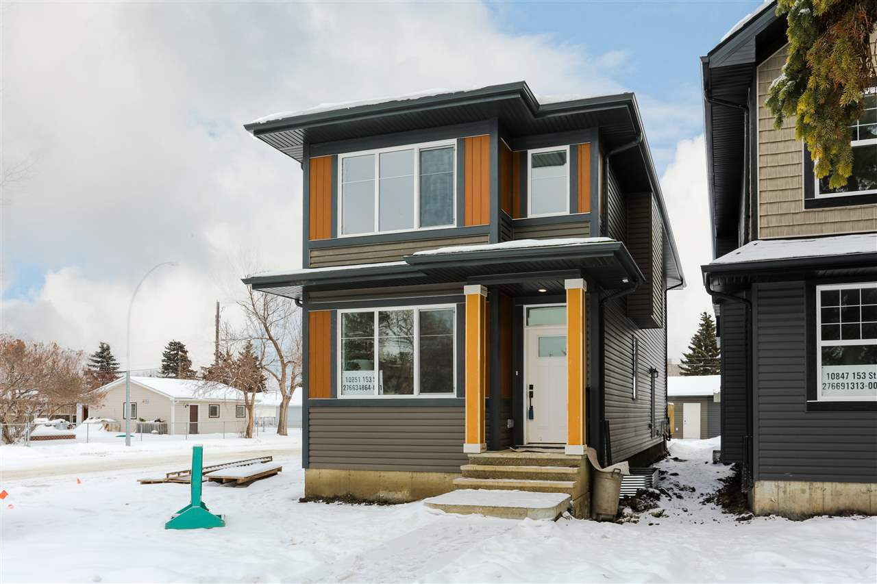 Brand new custom infill in an up and coming community. Enjoy a corner lot without the extra shoveling. This 1643 sq. ft. Single Family home welcomes you with a bright and spacious open concept main floor with separate entrance to the basement. The stunning kitchen showcases two tone cabinets and upgraded stainless steel appliances including chimney hood fan, built in microwave, and slide-in electric range. The living room surrounds a gas fireplace with stone and floating mantle. Upstairs features a large master bedroom over looking a tree lined street, complete with a 4 piece ensuite including tiled shower and walk-in closet. Down the hall is an additional 2 spacious bedrooms and laundry. Complimented by 9? main floor ceiling, quartz countertops throughout, and iron spindle railings.Outside you?ll find a large fully landscaped backyard, deck, fenced, and 20? x 22? double detached garage.  Just steps away from Ken Newman park with playground.