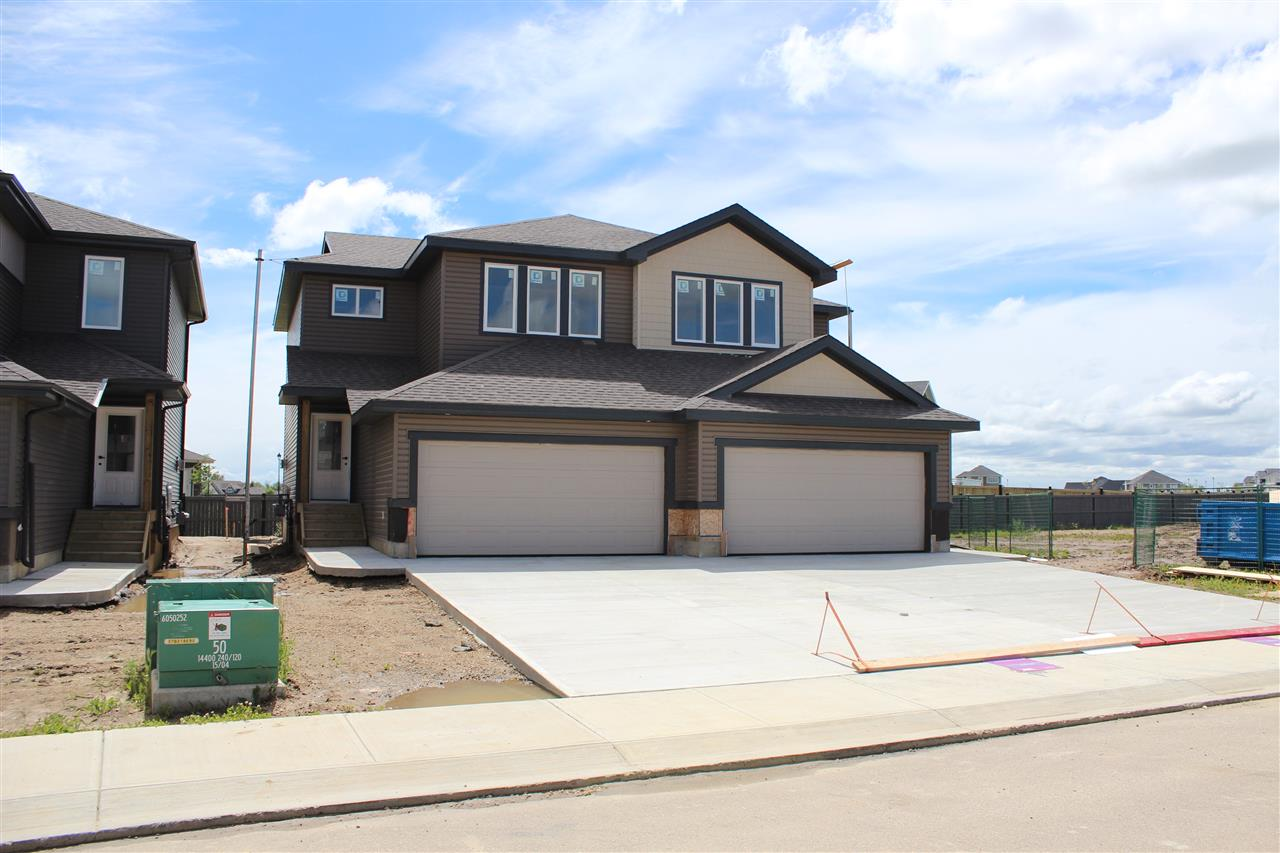 Welcome to the prestigious neighborhood of Genesis on the Lakes in the town of Stony Plain, just 20 mins west of Edmonton! Amenities are directly across the street and includes Sorrentino's restaurant, gas station and boutique shops. Elementary, junior and senior high schools are all just a short walk away. This Brand new Jafferbilt 1494 Sq.ft Two-Storey Half Duplex is currently under construction offering June 2019 Possessions. Open Concept Main Floor has 9 Ft Ceilings and offers Island Kitchen, Laundry, Dining room, Living room and 2 piece Bathroom. Upstairs has 3 Bedrooms. Master bedroom equipped with Walk in Closet, ensuite with a Sliding Barn door,his and her sinks and 36X60-inch Tiled Shower. Basement has 9 foot Ceilings and rough ins for future development .