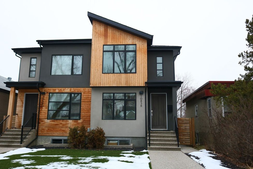 Amazing opportunity to live in the vibrant community of Allendale. This modern half duplex oozes that show home feeling with all the bling you could ever desire. Features include: bright open concept living, 9 ft ceilings, hand scraped hardwood floors, air conditioning, cozy gas fireplace, sleek 2 toned custom cabinetry in high gloss white and walnut, high end built in stainless steel appliances, and quartz countertops throughout. Upstairs you will find 3 good sized bedrooms and a 4 piece bath. The master boasts a spa-like ensuite and huge walk in closet. Out back you will find an extra large custom deck great for entertaining and a detached double garage. The landscaping is complete with artificial turf, front and back, which makes life just that much easier!! No need for a lawn mower!! This home also boasts a side entry door, which provides opportunities for future development of a basement suite. Welcome home!!