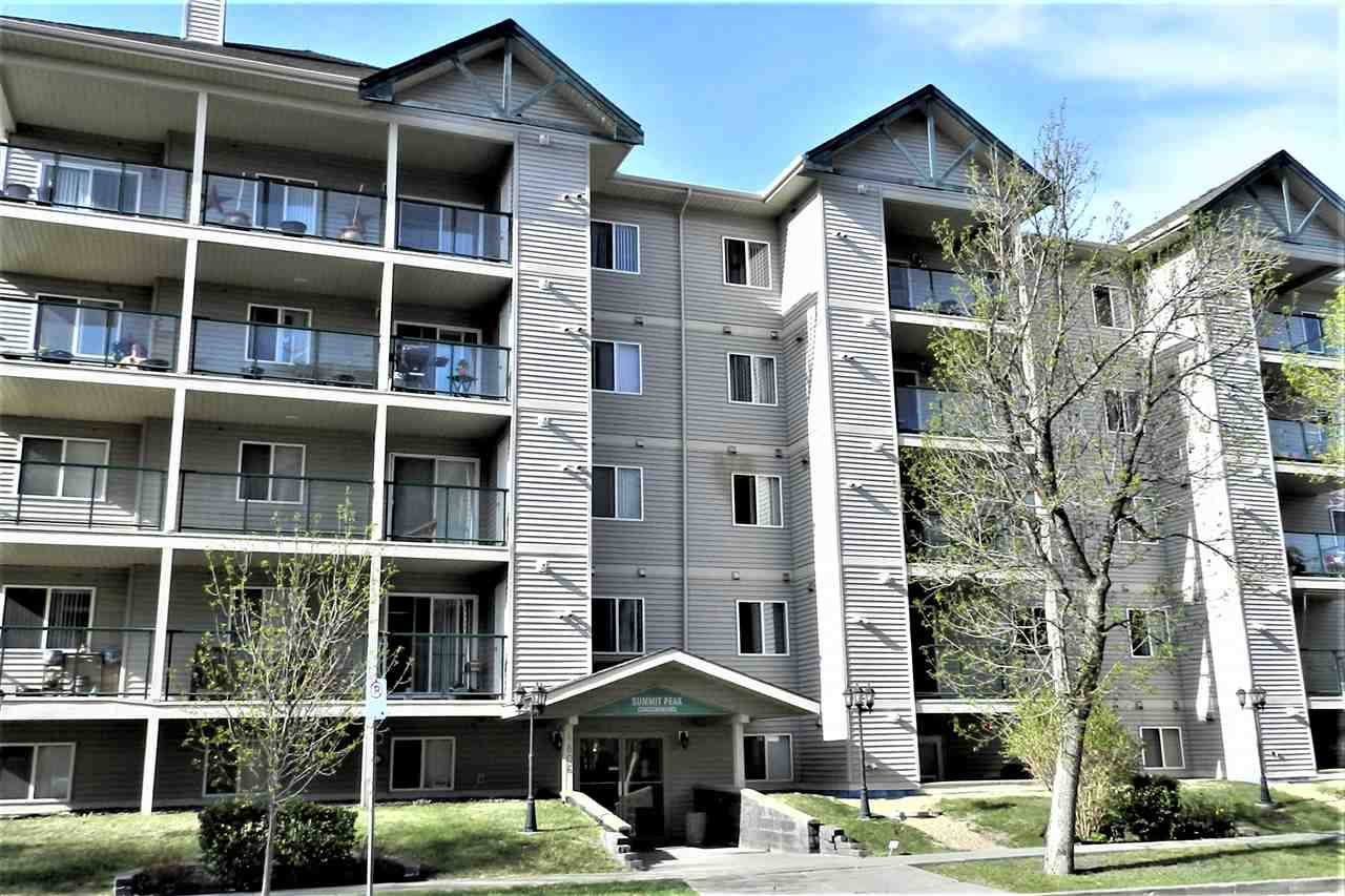 Sparkling clean and sporting a fresh new coat of paint in soothing neutral tones, brand new quality neutral toned carpet, this unit is well located in Central Leduc with good access to downtown, library, movie Theater and walking trails at Telford Lake.  The unit itself has an exceptional floorplan with a huge master bedroom providing lots of room for furnishings, including an area perfect for sitting area or office, double closets and convenient four piece ensuite.  Additional bedroom is a good size, insuite laundry is in place,  living room is comfortable with sliding patio doors to the extensive deck spanning 30 feet across the unit, kitchen is well equipped with lots of cabinets and counterspace.  An assigned Parking stall is provided in the heated underground parking,  Enjoy the advantage of owning a corner unit, with windows on two sides allowing lots of light.  This is an adult Complex for ages 30 plus.  Amenities include social/party room with kitchen and sitting area, equipped gym. elevator.