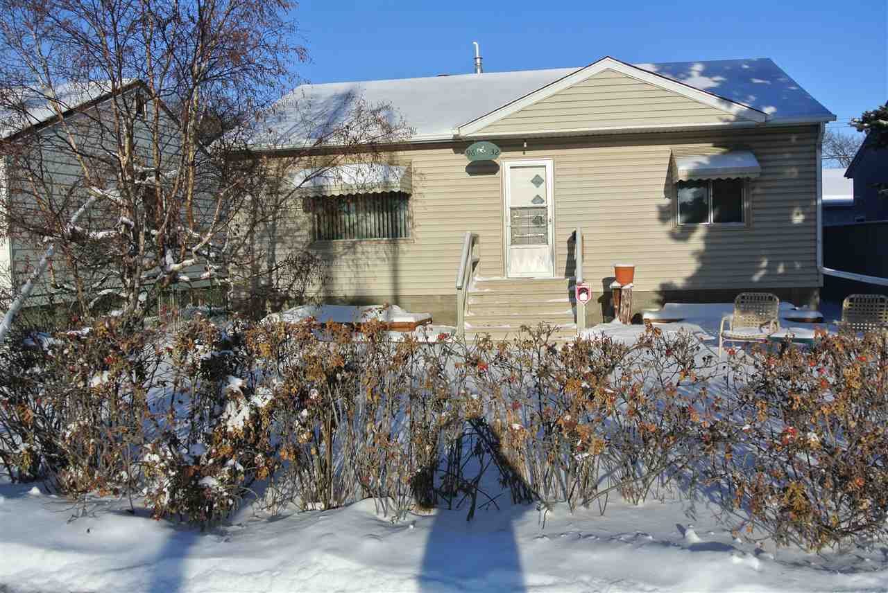 Lots of upgrades have been done to this super clean 2 plus 2 bedroom bungalow. 2 yr old hi efficient furnace, Tank-less hot water and central Air Conditioner. Newer vinyl siding , shingles and Laminate flooring. Also features additional laundry hookups upstairs, 100 Amp electrical, Rec room with Wet bar and 3 piece bath downstairs, 24' x24' double oversized heated Garage , 6' x 8' Green house , 10' x 16' Covered deck/outside entertainment room or huge shed with an overabundance of windows and screens. Please note 4th bedroom in Basement requires a door or privacy curtain.