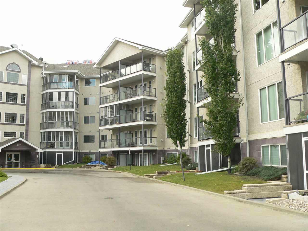 18+ Adult building.  In the heart of Sienna Pt., this open practical floor plan designed with privacy in mind is a 2 bed. 2 bath condo featuring:  Large spacious open plan kitchen with white cabinetry, adjacent living rm. with gas fireplace, patio doors to a covered deck, M. Bed. with 3 pc. en-suite & wi closet.  Opposite side, has 2nd bedroom, full bath & laundry/storage room.  All this with central air conditioning & situated on the 3thd floor overlooking center courtyard.  Comes with heated underground parking stall & storage cage.  Steps to Shopping, Professional Offices, Transit, & Restaurants!  Includes all utilities except electricity.
