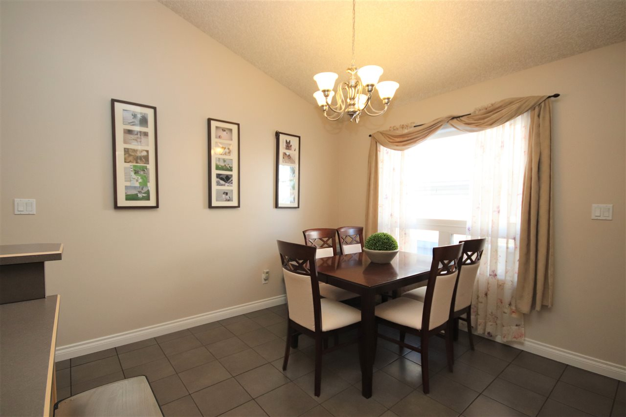 Tile floors extend into the dining room with an East facing window.