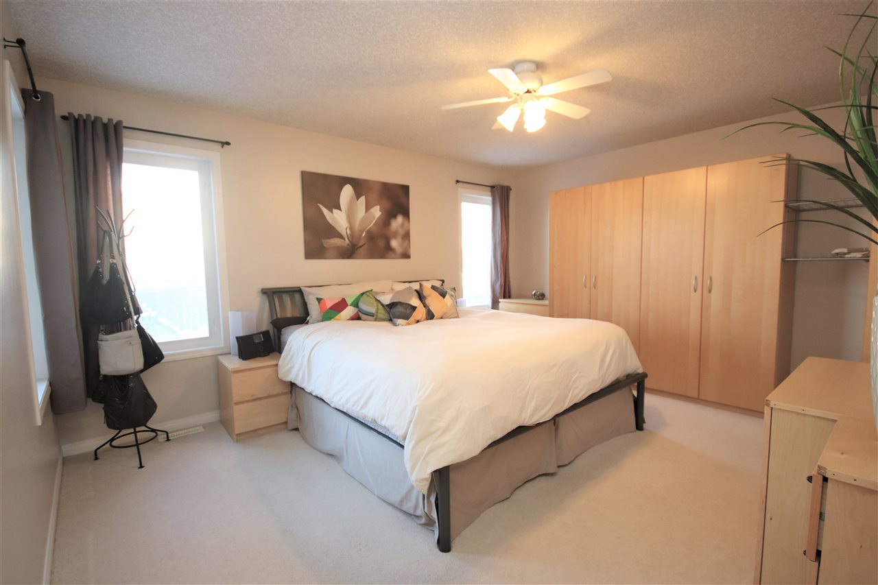 The king sized master suite is located off of the family room.