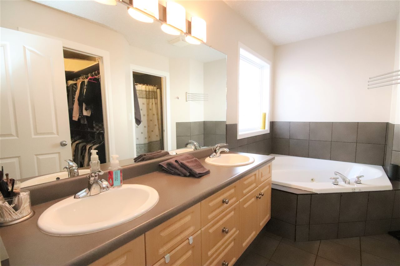 A 6 pce. spa ensuite with an oversized vanity and dual sinks.