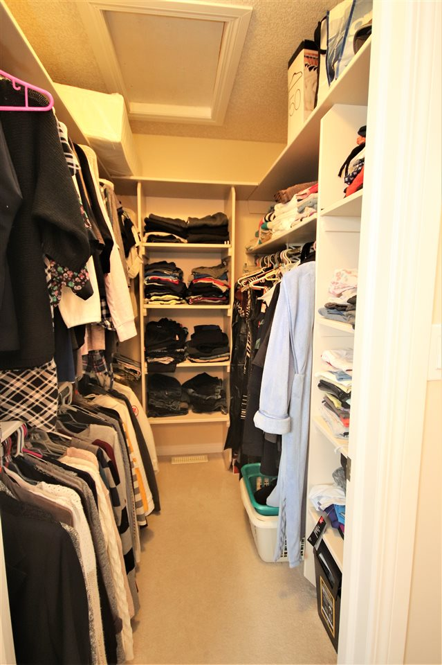 A fantastic walk-in closet with floor-to-ceiling built in shelving.