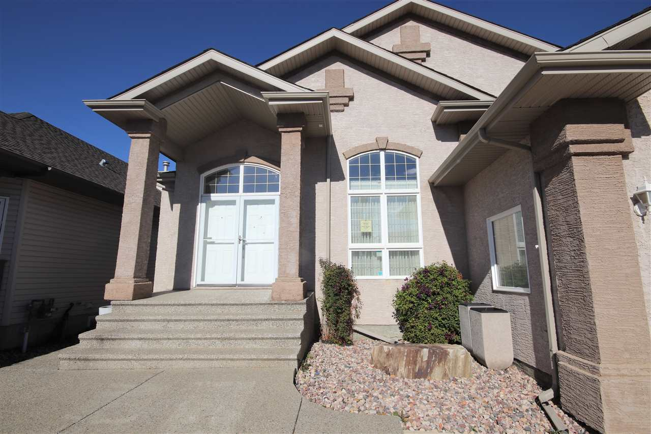 Low maintenance landscaped front yard, an exposed aggregate driveway and a lovely stucco exterior.