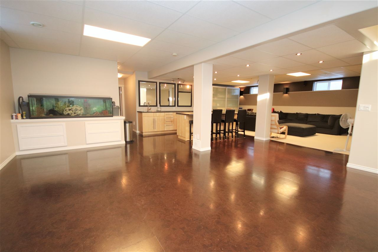 A basement made for entertaining!  This huge rec room boasts cork flooring, pot lighting and 9 ft. ceilings.