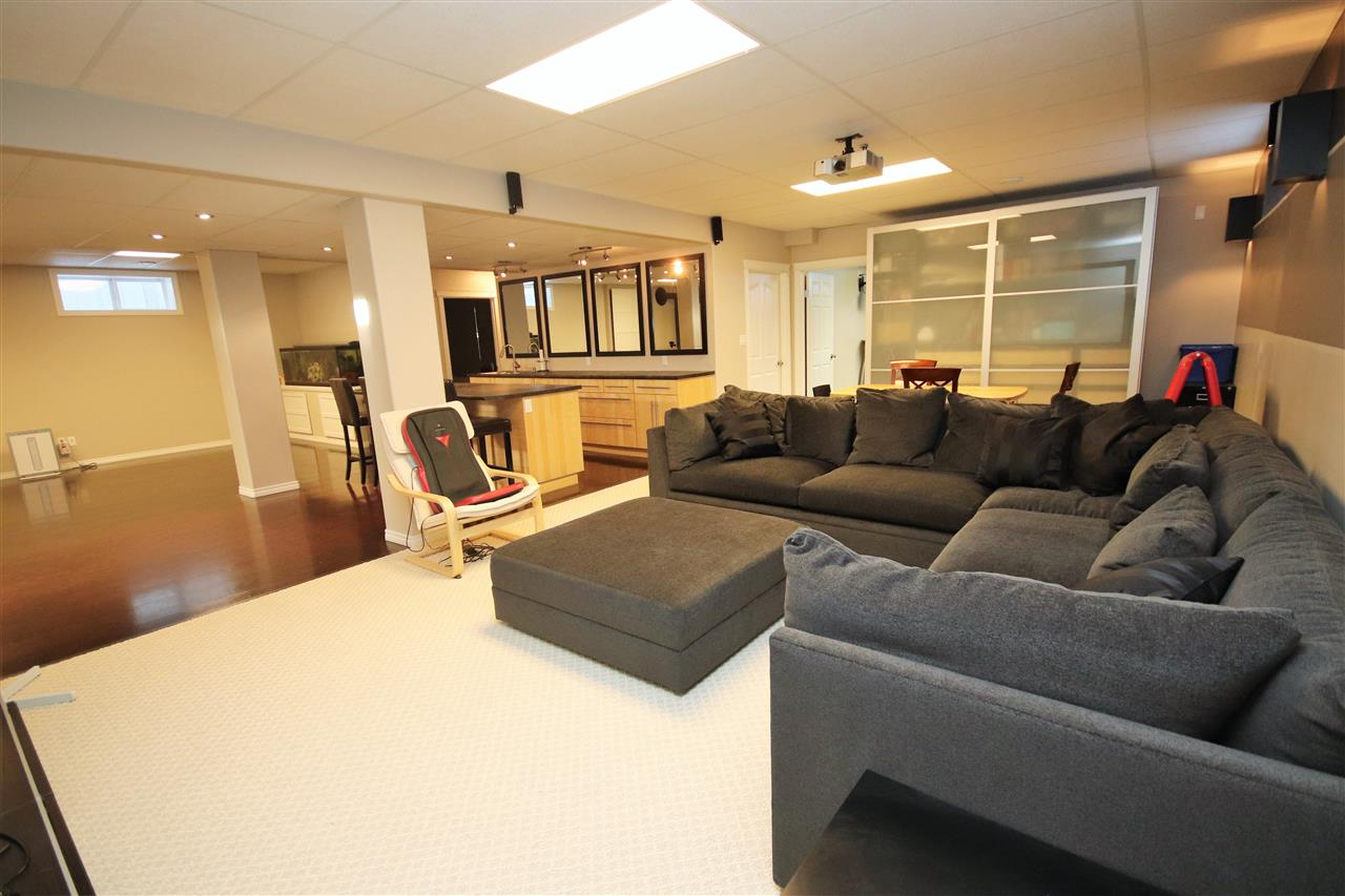 The screening area of the rec room is large enough for the biggest sectional, with space at the back for a card table.