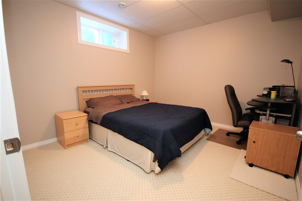 The 4th bedroom is located in the North West corner of the basement.