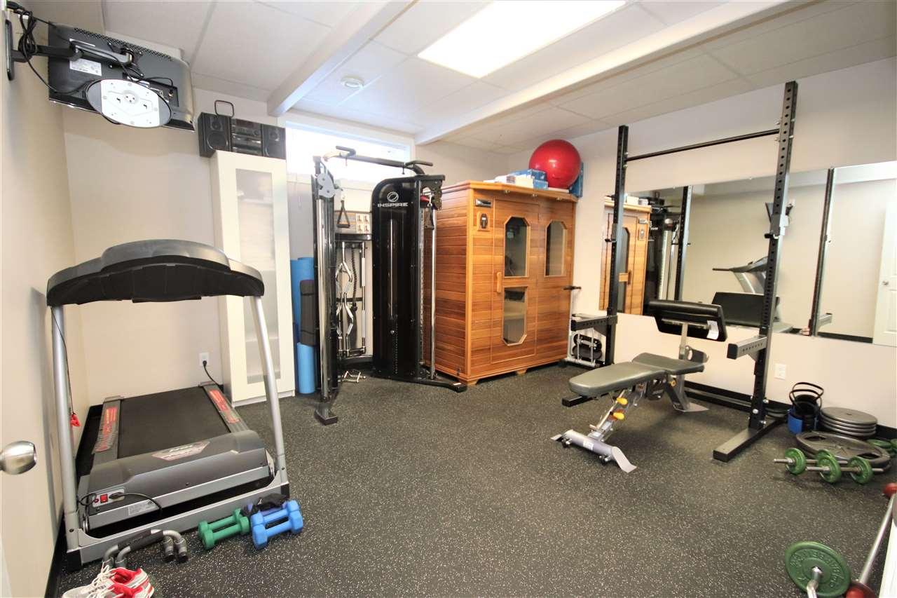 The gym/den has a rubber floor.