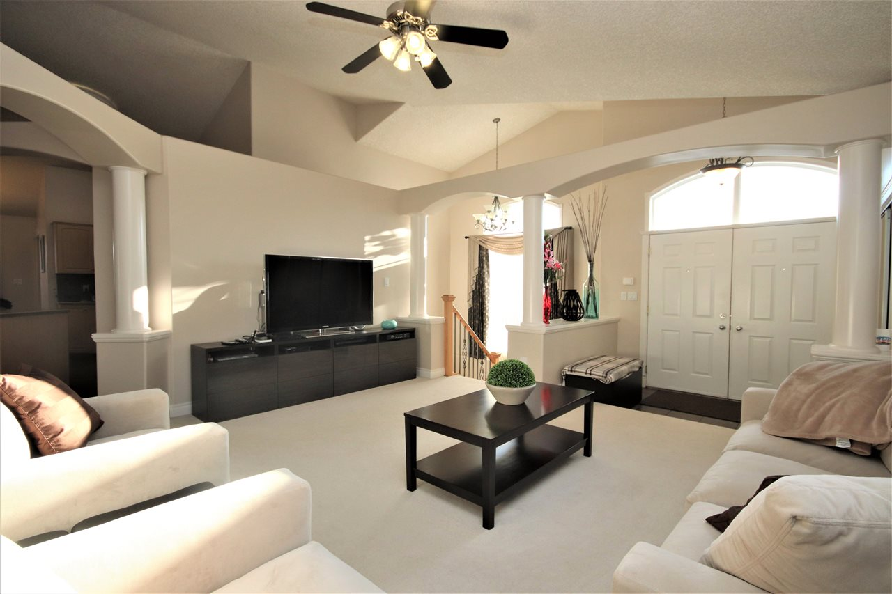 The entry opens into the front living room, A bright, airy space with vaulted, knockdown ceilings.  This home features central air conditioning.