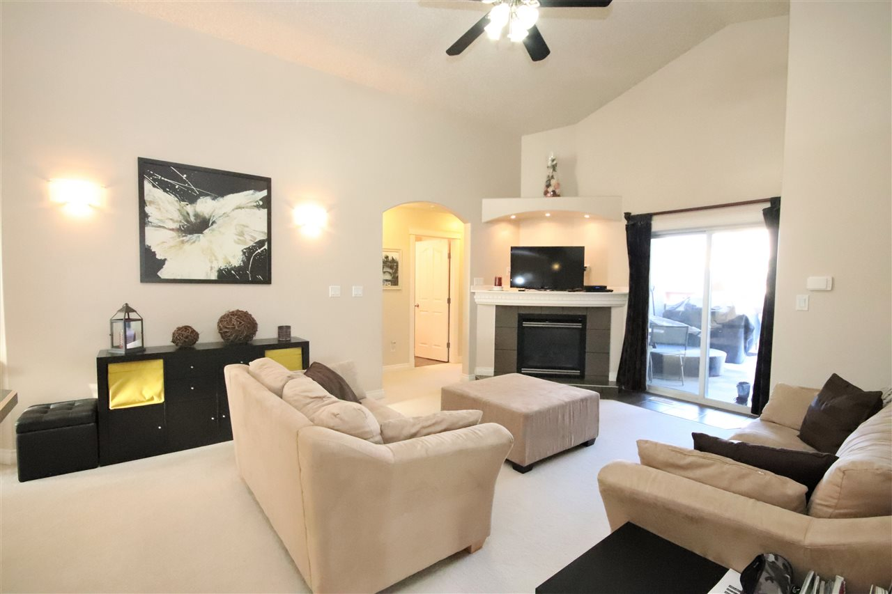 The family room also boasts a high, vaulted ceiling.  This space connects to the master bedroom on one side and two additional bedrooms on the other.