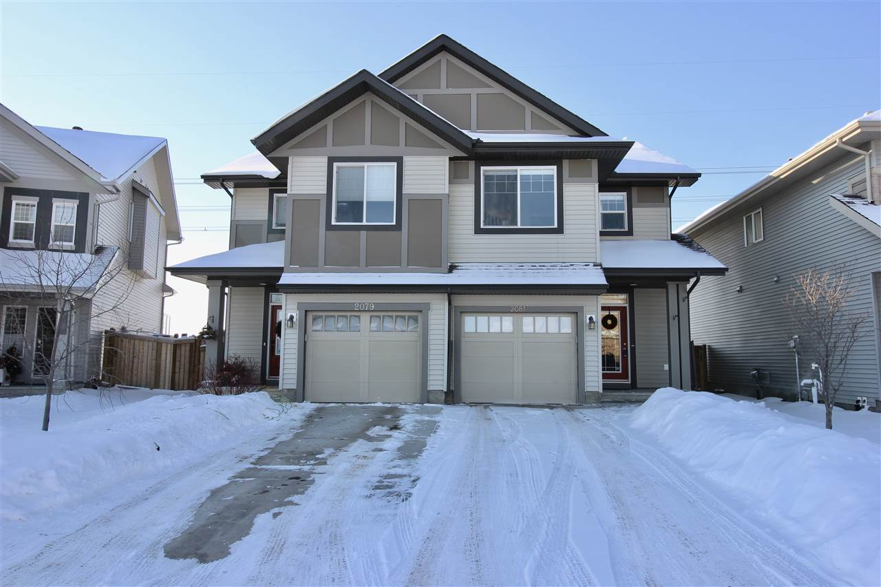 Welcome home to this executive 1400 sq ft half duplex located in the growing community of Chappelle Gardens! Backing onto a large walking trail area, featuring A/C and fully finished basement! Step into the spacious foyer and follow the hallway past the 2 pc bath and into the open concept main floor living area. The kitchen features a large island with overhang to place bar stools, walk in pantry, full height cabinets and tiled backsplash. Adjoing dining nook has sliding patio doors that lead you to your sunny back yard with deck and a shed. Upstairs is the huge master suite with full ensuite and large walk in closet. Upstairs laundry, main bath and 2 other good size bedrooms complete this level. The fully finished basement has rec room, 2 pc bath and loads of storage space. Attached single garage and very long driveway to park 2 cars on completes this package.Shopping, public transportation, parks and walking trails surround. This home is meticulously maintained and a must to view!