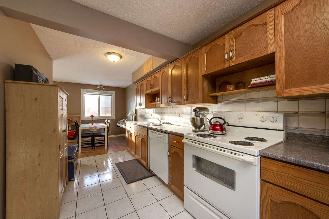 Amazing location backing onto green space, this 2-storey townhouse in North Edmonton.  Complex is very well maintained.  Many upgrades recently done: fridge (2019), exterior siding (2016), roof (2016-15), furnace(2015), fence (2014-2013), bathroom (2011), dishwasher (2010), washer/dryer (2010), & hot water tank (2009).  Galley kitchen with plenty of cupboard and countertop space, dining nook and open to living room.  Large windows through out for an abundance of natural light in the unit.  Laminate & tile flooring on main floor.  Upstairs there's 3 bedrooms & a completely renovated 4-piece bathroom with soaker tub.  Basement is partially finished, ideal for storage space.  Outside enjoy your south facing, fully fenced patio space with grass (condo board approves to changing your backyard space if owner chooses to do so).  Not looking into any neighbours.  Walking distance to Londonderry Mall, Rec Center, many surrounding schools, public transport and quick access to Anthony Henday & Yellowhead Trail.