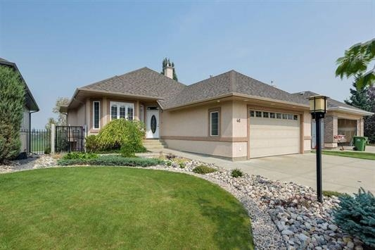 Located in Kingswood; within  5 minutes of Servus Place; & Anthony Henday.  1500 sq.ft walk-out Bungalow with private rear yard;  Open kitchen, maple cabinets, new black pearl leather granite counter tops; floor to ceiling fireplace; Brazilian Cherrywood hardwood; 2 bedrooms and a den large enough as a 3rd bedroom if required. Walk in Closet; 2 full baths and Laundry on main floor.  Floor to ceiling windows on main floor. Basement has a summer kitchen; in-floor hot water heating;  2 bedrooms; fireplace;  full bath; large windows;  and separate laundry area plus separate storage area. New Laminate flooring being placed in Suite. 24 x 24 garage; with in- floor drain; gas overhead heater.  Oversized driveway.  Private upper balcony with gas hook up for barbeque plus large patio and second gas connector for barbeque.  Property is well landscaped with perennials and easy to maintain.