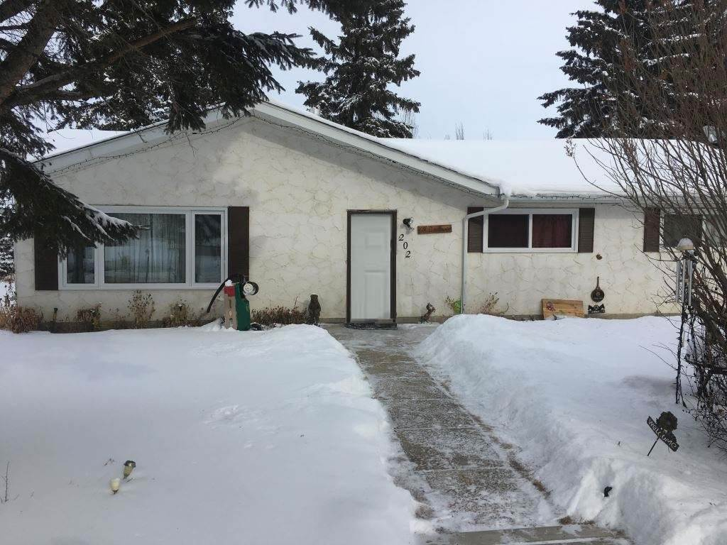 Peace and Serenity in living in the Village of Bittern Lake.  Approx. 15 km from Camrose, this town is just off Hwy 13. This cozy bungalow is on 2 lots and has attached single garage.  3 bedrooms, 2 bathrooms and large country kitchen dining area. Large Living Room.