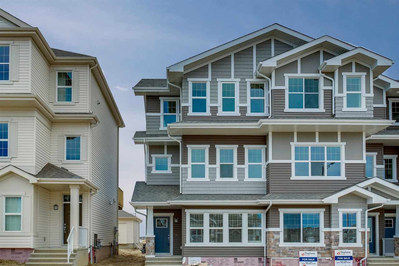 Welcome to Chappelle! An incredible opportunity to move into a new 3 storey townhouse that currently has over 1373sqft of finished living space with  MAIN FLOOR RENTAL SUITE!  ? there is over 2033sqft of total living space (567sqft main floor undeveloped space). The townhouse has 3 beds, 2.5 baths, 20x20 detached garage & more! Entering the home head up the stairs to the 2nd level that is bright & open concept. The spacious kitchen includes a large island with breakfast bar, beautiful cabinetry, granite counter tops & a large dining area. Step outside from the kitchen & enjoy the 10x10 deck. Back inside, the kitchen is open to the living room. Continue on to the 3rd level that includes the master suite with his/her walk-in closets & ensuite. Beds #2 & #3 are both a good size, upper laundry & 4 piece bath completes this level. The UNIQUE FEATURE of this property is the main floor ? this unfinished space can be developed into additional bedrooms, bathroom, living room & 2nd kitchen No Condo Fees!