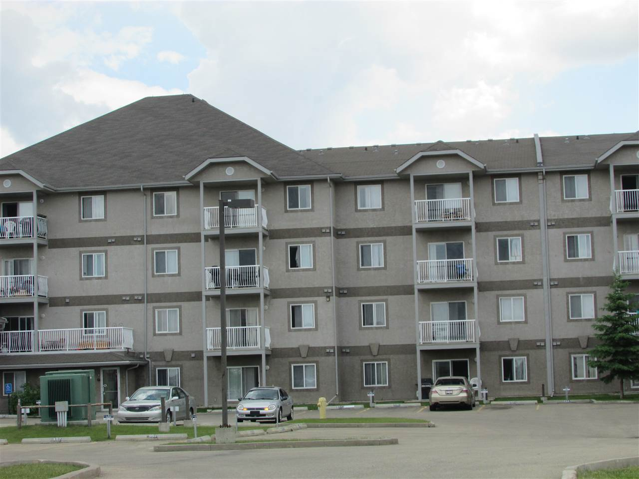 PERFECT FOR INVESTORS !!!   Tenant already in place !!!  This main floor unit is a 2 bedroom 2 bathroom with open concept living dining kitchen area. Kitchen has ample cupboards and layout would allow to add an island or breakfast bar.  Master bedroom has walk-thru closet & private full 4 pc ensuite.  Second bedroom is separated from the master with the 4 pc main bathroom just outside the door.  2 TITLED energized stalls are right in front of the unit.  Quick access to highway 16 and close to schools, shopping, playgrounds, walking trails, public transit and just steps away from the Tri-Leisure Center.  Well maintained & clean unit.  Carpets have been professionally cleaned.  Newer washer & dryer.  Common areas are video monitored, on-site security in the evenings & on-site resident manager.