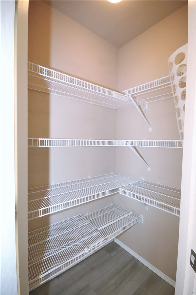 Adequate storage for extra staples and appliances within your large pantry.
