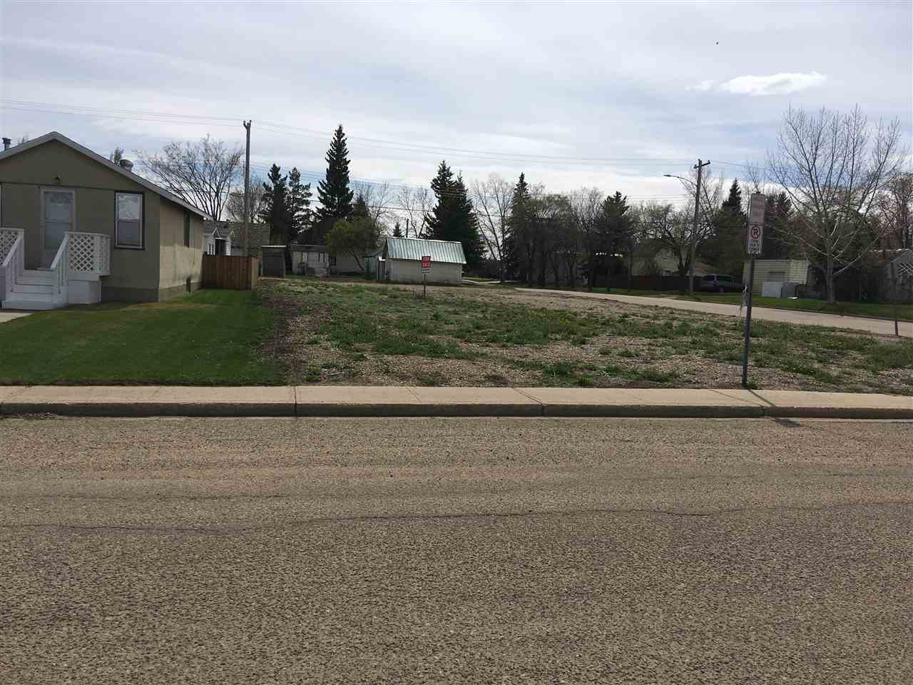 Large 50'X140' Vacant lot across from new clinic, close to shopping, school and hospital. Area is both residential and commercial. Lot is zoned residential but has the potential to be rezoned to multi-use or commercial. Build a home close to amenities or a business on this highly visible corner lot.