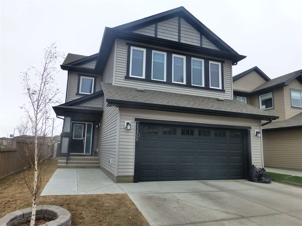 Be impressed with this bright and elegant fully finished home with a gorgeous lake view. Upon entering the home you will be greeted with a spacious foyer with sky high ceilings and plenty of windows that flood the house with natural light. This open concept home features a large living room with gas fireplace, the beautiful kitchen with a centre island, plenty of cabinets and counter space, SS appliances, granite countertops and a large pantry. Upstairs you will find a massive bonus room, 3 large bedrooms, the master complete with a walk in closet and a beautiful ensuite. The fully finished basement was completed by the builder offering a family room with gas fireplace, 4th bedroom, 4 pc bathroom and a storage room. The yard boasts a massive deck with incredible lake views. The garage is oversized with a drain. close to schools, transportation and easy access to the Henday.