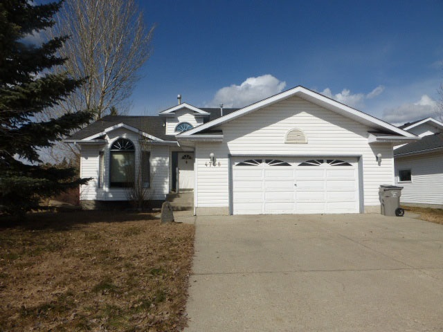 This lovely four level split is located in the newer subdivision of Thorsby.  Built in 1990 by Shadow Ridge, this great family home boasts a huge kitchen with loads of custom oak cabinets, pantry, angled island with breakfast bar, decorative corner glass cabinet & sunshine ceiling. Dishwasher new in 2016.  Adjacent dinette features a bay window & garden door to back deck which was built in 2018.  Cozy living room has a bay window & vaulted ceiling.  Front entry has a high ceiling, closet & window over the front door.  The upper level features 3 good sized bedrooms with the master bedroom boasting a W/I closet, 3 pce ensuite with corner shower.  4 pce main bathroom with oak vanity completes the upper level.  3rd level features a bright family room with WB F/P with oak mantle, ceramic surround.  A 4th bedroom, 3 pce bathroom with shower, laundry room & entry into att garage. W/D new in  2018.  The 4th level has a large RR, furnace/storage room.  Large back yard.  Double attached garage.