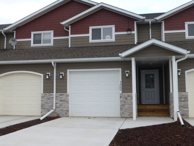 Built in 2017, brand new, never lived in! Located on a quiet street in Thorsby, this 1556 sq. ft. townhouse boasts an open concept floor plan, neutral colours & superior finishing. Spacious front entry features convenient closet, 2 pce powder room & access to single att. garage. The great room boasts a lovely kitchen with loads of cabinets, centre island with sink, trendy backsplash, S/S appliances, pot lights & WI pantry. Adjacent dinette is large enough to fit a good sized table & features patio door which leads to the back deck. The bright & spacious LR completes the main level. The upper level features 3 bedrooms all with carpet & the master boasts a WI & 4 pce ens. Laundry room & 4 pce bathroom completes the upper level. The basement is full & open. GST is included. Progressive New Home Warranty. There are 4 years remaining of the Town of Thorsby tax incentives where the municipal portion is reduced or waived. 2nd year is 100%, 3rd & 4th year is 50%, 5th year is 25%.