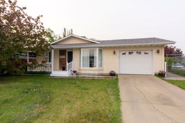 AMAZING VALUE, FULLY FINISHED HOME with 4 BEDROOMS & DEN! 1085 sqft bungalow with attached garage.  Most recent UPGRADES INCLUDE: SHINGLES (2019 NOT SEEN IN PHOTOS) FRONT WINDOW (2019) FLOORING (laminate upstairs, carpet downstairs), WINDOWS (basement), HOT WATER TANK, ELECTRICAL, WASHER & DRYER, & PAINT.  CRESCENT LOCATION, FULLY FENCED LOT, LARGE BACKYARD with shed, & just a block from the ELEMENTARY SCHOOL & PARK. You'll appreciate what this home has to offer.